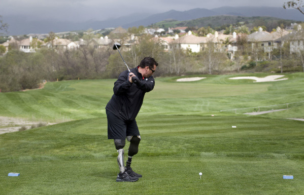Master Sergeant Davey Lind takes a tee shot during a benefit golf tournament for the Marine Semper Fi Fund at the Coto de Caza Golf Club.  Lind lost both his legs at the knee after an IUD exploded under his vehicle while servine in Iraq in 2007.  He and his family benifited from the fund during his road to recorvery.          ///ADDITIONAL INFO:     01.s.marineGolf.0308.pb 03/08/2010      Paul Bersebach, The Orange County Register